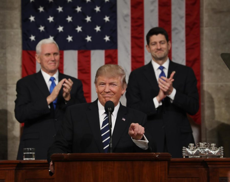 WASHINGTON, USA - FEBRUARY 28: (----EDITORIAL USE ONLY  MANDATORY CREDIT - JIM LO SCALZO / EPA / POOL - NO MARKETING NO ADVERTISING CAMPAIGNS - DISTRIBUTED AS A SERVICE TO CLIENTS----) US Vice President Mike Pence (L) and Speaker of the House Paul Ryan (R) applaud as US President Donald J. Trump (C) arrives to deliver his first address to a joint session of Congress from the floor of the House of Representatives in Washington, United States on February 28, 2017. Traditionally the first address to a joint session of Congress by a newly-elected president is not referred to as a State of the Union.  (Photo by Jim Lo Scalzo/EPA/Pool/Anadolu Agency/Getty Images)